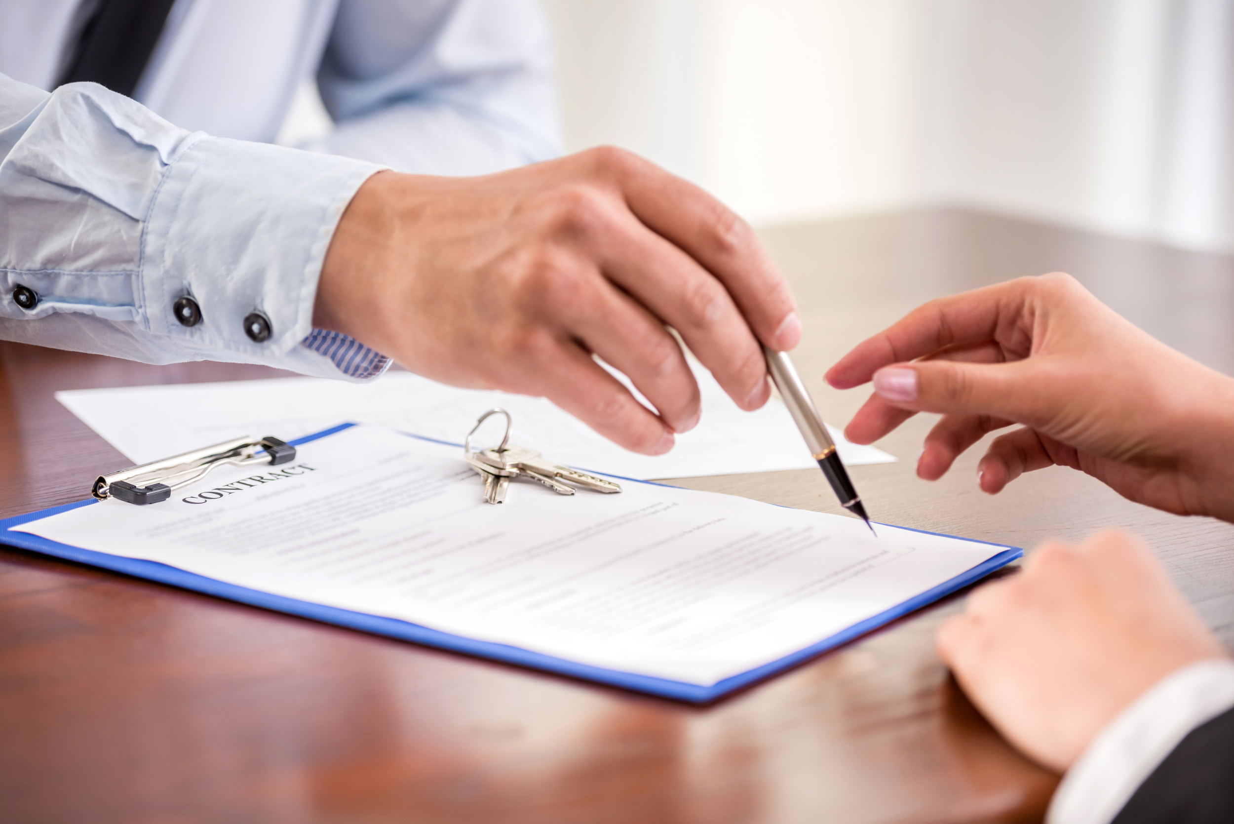 Close up of mortgage documents being signed